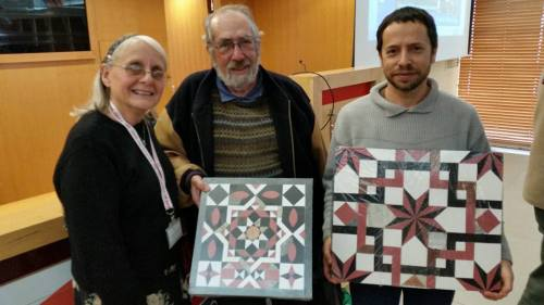Frankie Snyder, Gabriel Barkay, and Zachi Dvira, showing reconstructions of crusader floor tiles from The Dome of the Rock. Photo: Temple Mount Sifting Project.