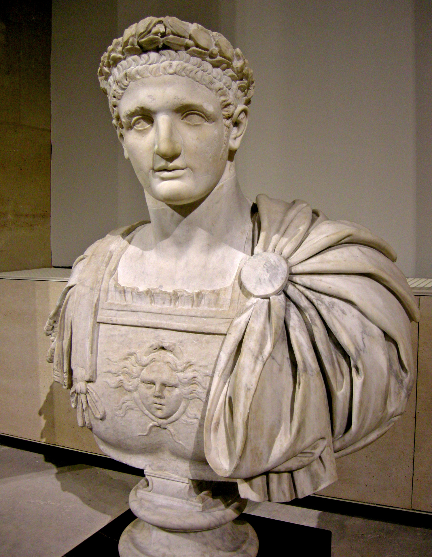 Bust of Domitian as Emperor (head from antiquity, body from the 18th century), but depicted as a youth, in the Louvre, Paris. Notice his vertically layered Neronian style haircut.